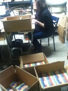 Melissa, one of the project directors, unpacking our new book!